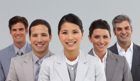 Multi-ethnic business people standing together Royalty Free Stock Images