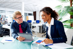 Multi ethnic business people teamwork touch pad Stock Photos