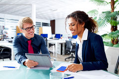 Multi ethnic business people teamwork touch pad Royalty Free Stock Photos