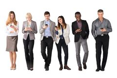 Multi Ethnic Business People Using Cell Phones stock photography