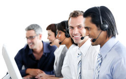 Multi-ethnic business people using headset. In a call center Royalty Free Stock Images