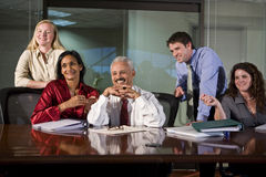 Multi-ethnic business team in boardroom royalty free stock photography