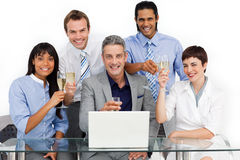 Multi-ethnic business team celebrating a success Royalty Free Stock Photography
