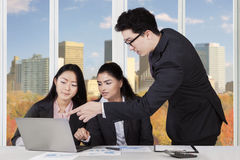 Multi ethnic business team discussing at workplace Stock Photo
