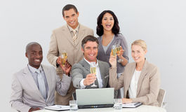 Multi-ethnic business team drinking champagne Royalty Free Stock Images