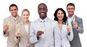 Multi-ethnic business team drinking champagne Stock Image