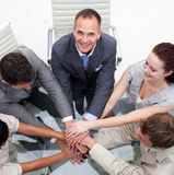 Multi-ethnic business team with hands together Royalty Free Stock Photos