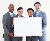 Multi-ethnic business team holding white card