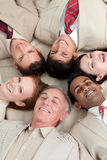 Multi-ethnic business team lying in a circle Stock Photo