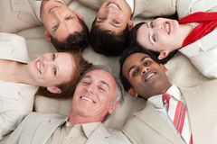 Multi-ethnic business team lying in a circle Royalty Free Stock Photos