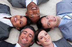 Multi-ethnic business team lying on the floor Stock Image