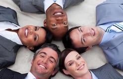 Multi-ethnic business team lying on the floor Stock Image