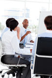 Multi-ethnic business team at a meeting royalty free stock image