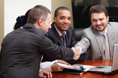 Multi ethnic business team at a meeting stock image