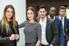 Multi-ethnic business team standing in an office building royalty free stock images