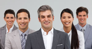 Multi-ethnic business team standing together Stock Photography
