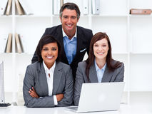 Multi-ethnic business team working at a computer Stock Photo
