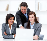 Multi-ethnic business team working at a computer Stock Photography