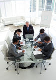 Multi-ethnic business team working together Royalty Free Stock Photography