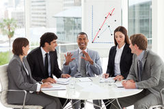 Multi-ethnic business team working together in a m Stock Images