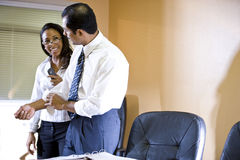 Multi-ethnic businessman and businesswoman working Stock Photos