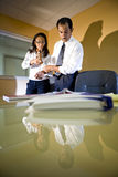 Multi-ethnic businessman and businesswoman working Royalty Free Stock Photo