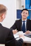 Multi-ethnic businessmen during meeting Stock Photos