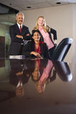 Multi-ethnic businesspeople in boardroom Stock Image