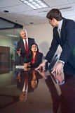 Multi-ethnic businesspeople in boardroom Stock Photography