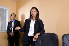 Multi-ethnic businesspeople in office boardroom Stock Photos