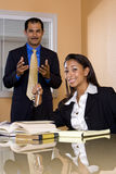 Multi-ethnic businesspeople in office boardroom Stock Image