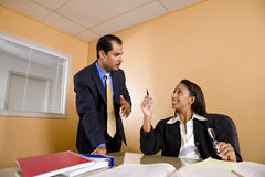 Multi-ethnic businesspeople in office boardroom Royalty Free Stock Image