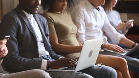 Multi-ethnic people group immersed in phones laptops, obsessed with devices stock footage