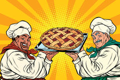Multi-ethnic chefs with berry pie Royalty Free Stock Image