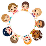 Multi-ethnic Children Group. Multi-ethnic group of children holding a white round billboard Stock Image