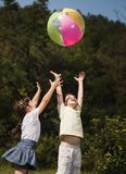 Multi-ethnic children playing ball Stock Images