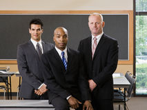 Multi-ethnic co-workers posing in conference room Stock Image