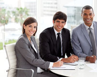 Multi-ethnic co-workers smiling at the camera Stock Images