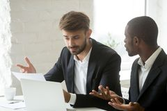 Multi-ethnic colleagues having fight arguing about mistake in bu. Multi-ethnic colleagues having claims fight about mistake in business document, diverse royalty free stock images