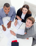 Multi-ethnic colleagues smiling at the camer Royalty Free Stock Images