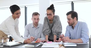 Multi ethnic company workers group brainstorm at office meeting table