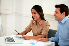 Multi ethnic coworkers working on documents Stock Photo