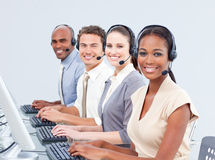 Multi-ethnic customer service representatives. Using headset in a call-center