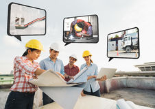Multi-ethnic diverse group of construction development project partner meeting at building site, work on strategy planning royalty free stock photos