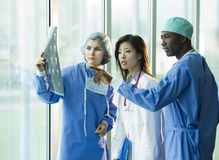 Multi-ethnic doctors consulting Stock Photography