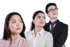Multi ethnic employees looking at copyspace Royalty Free Stock Photos