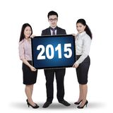 Multi ethnic entrepreneurs with numbers 2015 Royalty Free Stock Photography