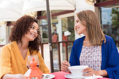 Multi-ethnic friends at bar's balcony Royalty Free Stock Image
