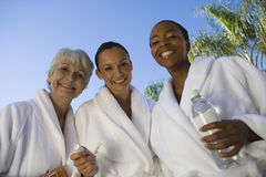 Multi Ethnic Friends In Bathrobe Smiling Stock Photography