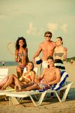 Multi ethnic friends on a beach Royalty Free Stock Images